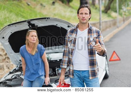 Couple after a car breakdown at the side of the road