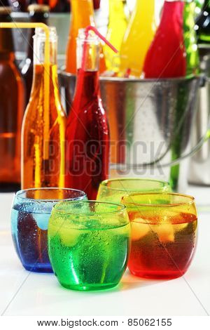 Glassware of different drinks, closeup