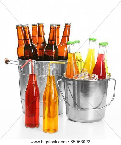 Glassware of different drinks in metal buckets isolated on white