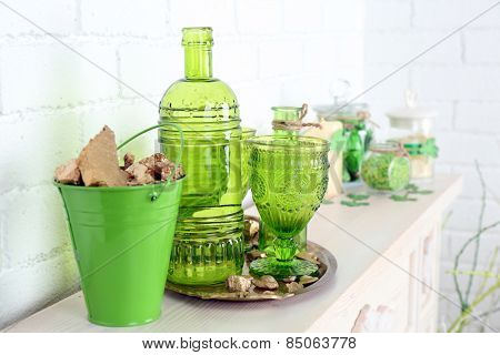 Composition with gold in bucket for St Patrick Day on brick wall background