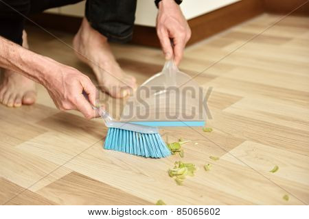 Sweeping using brush and dustpan