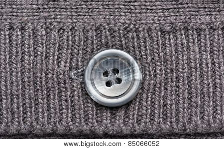 grey knitted wool with button