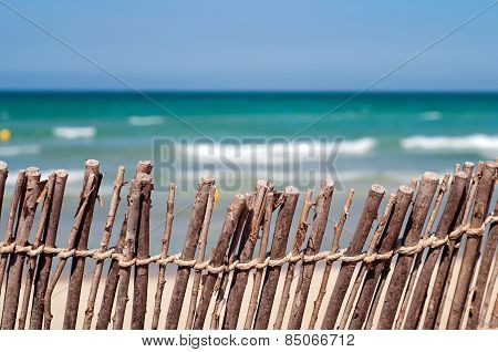 Short Of A Fence At The Beach