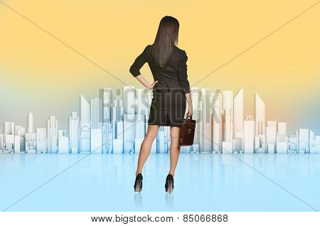Business woman turned back looks at the city