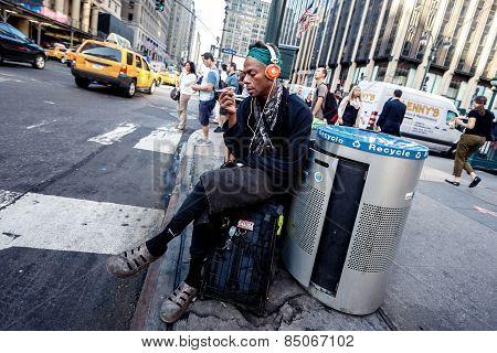 African american man resting near road
