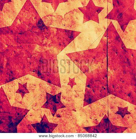 star shapes on a paper bag with texture added in toned with a retro vintage instagram filter app or action effect