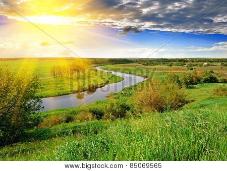Spring Meadow And River In The Evening