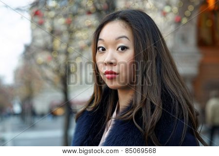 simpotichnoy portrait asian girl in a coat with a fur collar