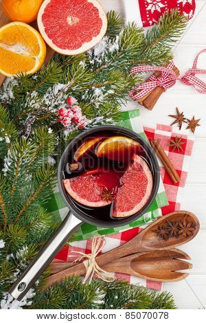 Christmas mulled wine on wooden table. View from above
