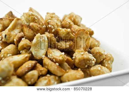Crispy Peanut With Sesame In Plate On White Background