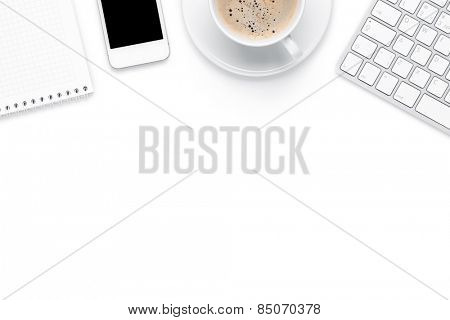 Office desk table with computer, supplies and coffee cup. Isolated on white background. Top view with copy space