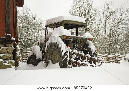 Hibernating snowbound tractor