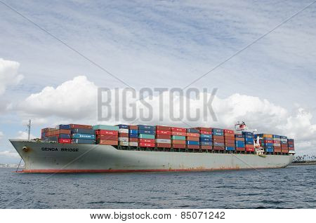 Cargo Ship Waiting To Be Unloaded In Long Beach, California