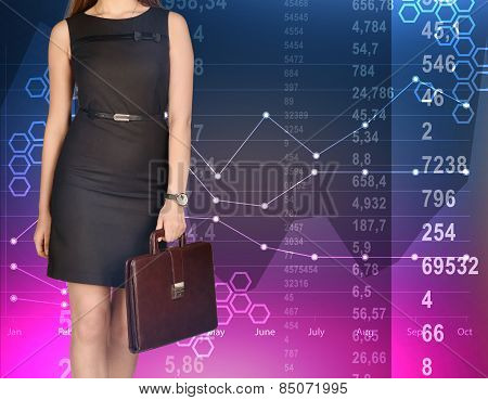 office girl holding leather briefcase on colorful background of diagrams