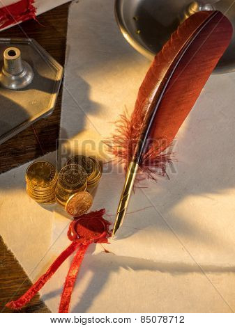 Twenty Swiss Francs gold with feather pen and old parchments