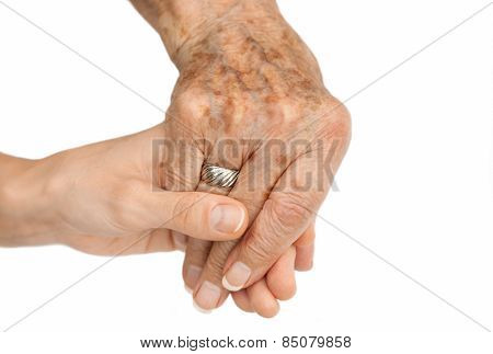 Old hand holding young hand, on white background