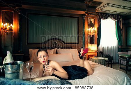 Elegant woman lying on the bed