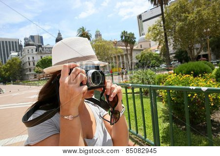 Tourist taking picture in Plaza de Mayo, Buenos Aires