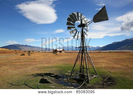 Windmill in Argentinian farmland