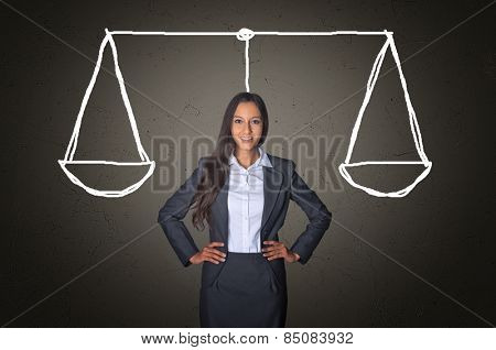 Conceptual Confident Young Businesswoman on a Gray Gradient Background with Balance Justice Scale Drawing.