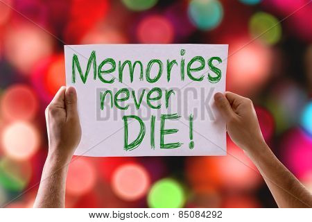 Memories Never Die card with colorful background with defocused lights