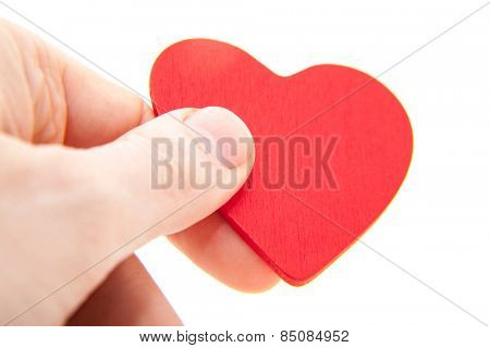 Hand holding red heart. All on white background.
