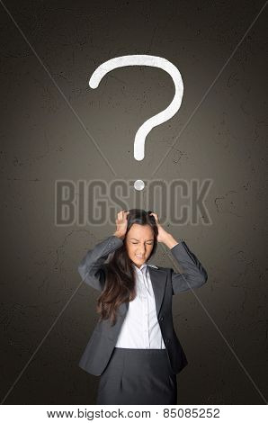 Frustrated Young Businesswoman with Conceptual Question Mark Above her on Abstract Gray Gradient Background.