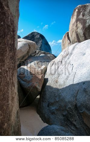 Close up Granite Boulders at the Baths in Virgin Gorda Island of Caribbean Under Blue Sky.