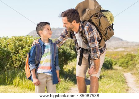 Father and son on a hike together on a sunny day
