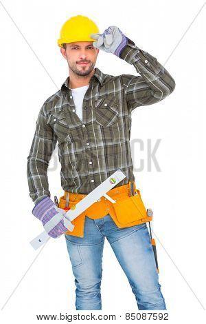 Repairman holding spirit level on white background