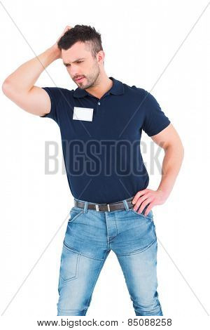 Confused male technician scratching head on white background