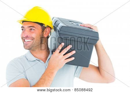 Confident handyman carrying toolbox on shoulder over white background