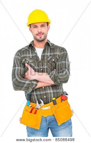 Manual worker with tool belt on white background
