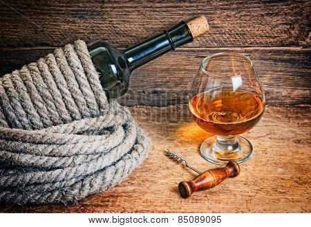 Bottle Of Wine Wrapped With Rope
