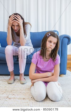 Mother and daughter after an argument at home in the living room