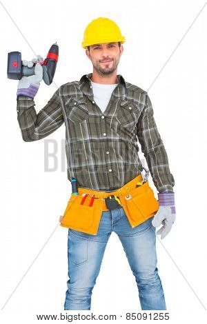 Handyman wearing tool belt while holding power drill on white background