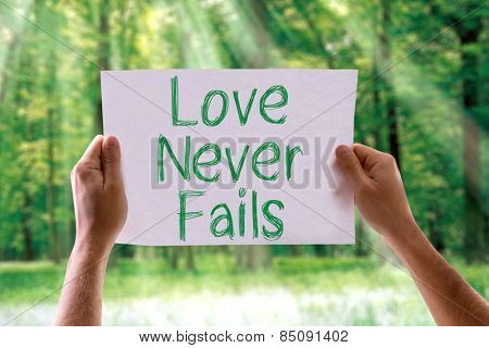 Love Never Fails card with nature background