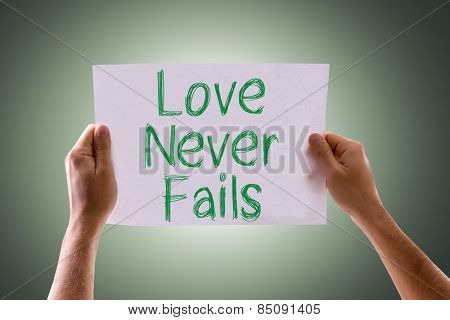Love Never Fails card with green background
