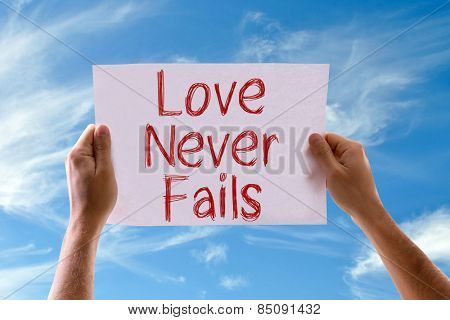 Love Never Fails card with sky background
