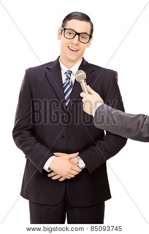 Vertical shot of a young businessman being interviewed isolated on white background