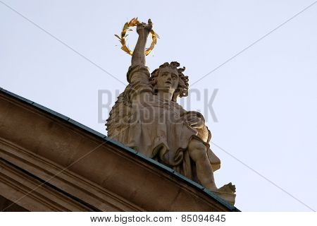 GRAZ, AUSTRIA - JANUARY 10, 2015: Angel on the portal of St. Catherines church and Mausoleum of Ferdinand II, Graz, Austria on January 10, 2015.