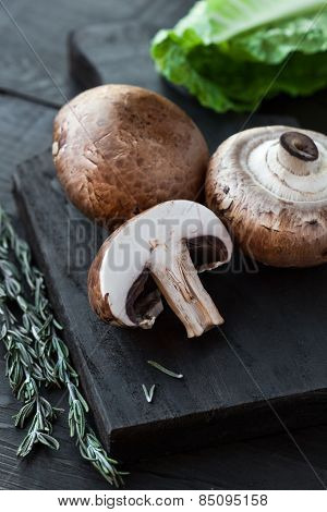 Raw Portobello Mushrooms On Cutting Board