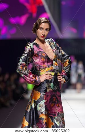 ZAGREB, CROATIA - OCTOBER 18, 2014: Fashion model wearing clothes designed by Envy Room on the 'Fashion.hr' fashion show