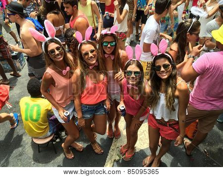 Street carnival parade in Rio de Janeiro, Brazil 2015 : Young women having party fun