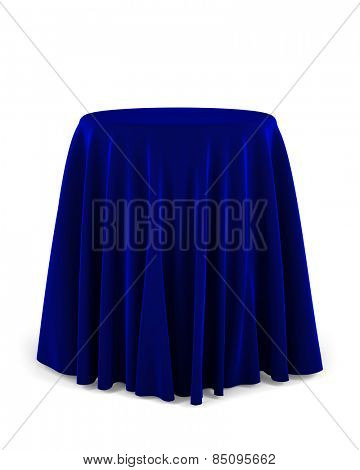 Round presentation pedestal covered with a blue cloth over white background