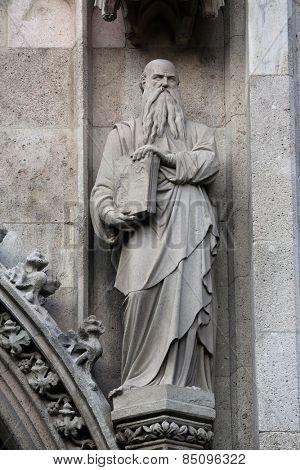 VIENNA, AUSTRIA - OCTOBER 10: Statue of Saint, Votivkirche (The Votive Church). It is a neo-Gothic church in Vienna, Austria on October 10, 2014