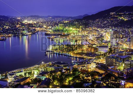 Nagasaki, Japan skyline in the bay.