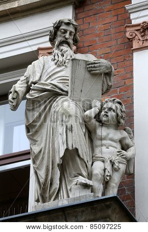 VIENNA, AUSTRIA - OCTOBER 10: Saint Matthew the Evangelist on the facade of Evangelical School in Vienna, Austria on October 10, 2014.