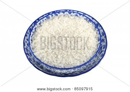 A bowl filled with short grain Japanese Rice, isolated on white background