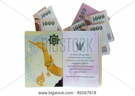 Thai electronic passport (issued by a government in Thailand), with folded 500 and 1000 Baht Banknotes, isolated on white background